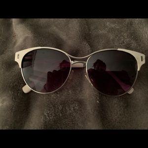 Jessica Simpson white-rimmed sunglasses